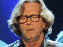 An auction of many of rock legend Eric Clapton's guitars fetches millions of dollars for charity.