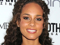 Alicia Keys says that she is looking forward to becoming a mother next month.