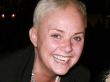 Gail Porter nearly slips out of her baggy top as she poses for the camera with daughter Honey Porter