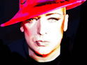 Boy George allegedly pours a drink over a fan at the Embassy club in London.