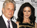 Michael Douglas confronts a gang of photographers after Catherine Zeta-Jones accuses one of punching her.