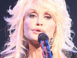 Dolly Parton performing on the Kenny Rogers: the First 50 Years Television Special