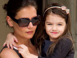 Actress Katie Holmes leaving her New York City apartment building with daughter Suri Cruise