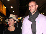 Dannii Minogue and her partner Kris Smith arrive at Heathrow Airport