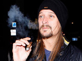 Kid Rock smokes a cigar as he leaves Trousdale night club, Los Angeles