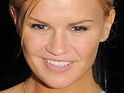A friend of Kerry Katona claims the star is smitten with a painter and decorator from Cheshire.
