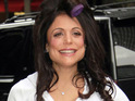 Bethenny Frankel poses in a swimsuit less than a month after giving birth to daughter Bryn.
