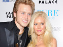 Heidi Montag and Spencer Pratt are photographed kissing during a trip to the zoo.
