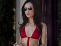 Nikita star Maggie Q says that she hated having to wear a revealing swimsuit for the show.