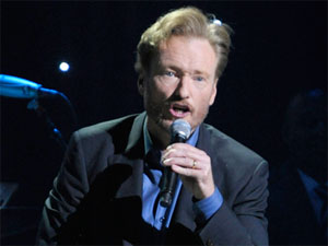 Conan O'Brien performing on his live stand up tour