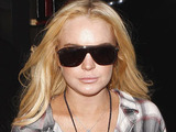 Lindsay Lohan wears slouchy boots to hide her scram ankle bracelet as she shops in Beverly Hills