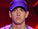 Eminem claims that he doesn't dislike gay people and defends his song lyrics during an interview.