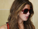 Ashley Greene says that she hopes that living in New York will allow her to escape the paparazzi.