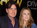 "Charlie Sheen calls Brooke Mueller ""a chubby weirdo"" after she fails to get a restraining order."