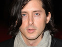 "Carl Barat says that the cover of his album is ""just photographic"", after the image is mocked by fans."