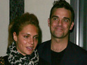 Robbie Williams marries Ayda Field at his LA mansion.