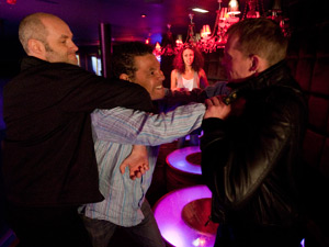 He starts a fight suspecting the bouncers in the club responsible,