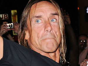 Iggy Pop leaves Yonge-Dundas Square after performing at the 2010 NXNE outdoor concert, Canada
