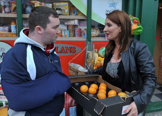 Carol handing out Vitamin C to junkies on Christmas morning - Courtesy of Digital Spy