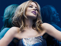 Kylie Minogue says that she wishes her songs about fighting cancer had made Aphrodite.