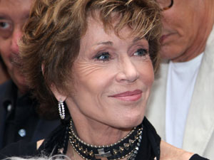 Jane Fonda leaves her hotel with her dog, France