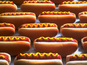 A former hot dog eating champion is arrested after gatecrashing this year's event in New York.