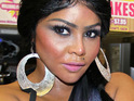 "Lil' Kim is said to be a ""perfect match"" to promote Three Olives' new grape-flavoured vodka drink."