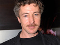 "Aidan Gillen says British actors do well in the US because they don't mind playing ""scumbags""."