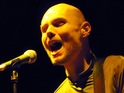 Smashing Pumpkins frontman Billy Corgan collapses on stage.