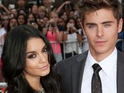 Zac Efron reportedly tips girlfriend Vanessa Hudgens during a strip tease on stage for Rent.