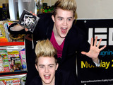 Jedward signing copies of their album