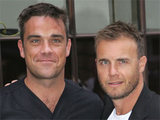 Recently re-united 'Take That' bandmates Robbie Williams and Gary Barlow arrive at the Radio 1 studios in London, England