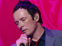Stone Temple Pilots frontman Scott Weiland falls off an elevated stage during a concert.