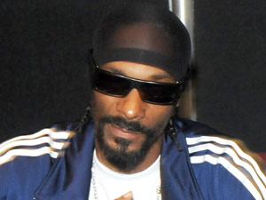 Rapper Snoop Dogg greats fans during Landy Cognac VS signing