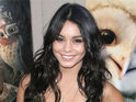 Vanessa Hudgens says that Zac Efron's beard is growing on her.
