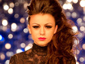 A tabloid report claims that Cher Lloyd and Cheryl Cole have argued backstage on The X Factor.