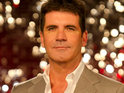 "Simon Cowell mocks Louis Walsh on Xtra Factor, calling him ""smug"" and ""arrogant""."