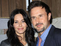 "Courteney Cox and David Arquette reportedly share ""quiet laughs"" at a press conference for Scream 4."