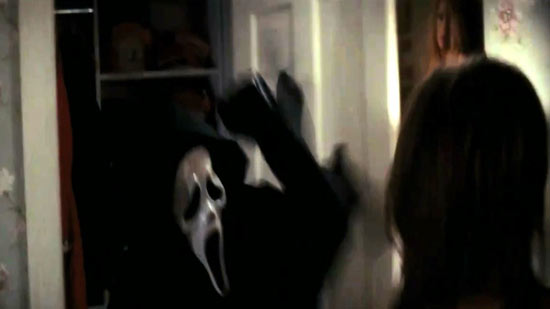 Ghostface leaps out of a wardrobe.