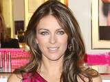 Elizabeth Hurley signs the Estee Lauder Pink Ribbon Collection