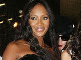 Naomi Campbell presents a collection of t-shirts at Dolce & Gabbana store