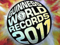 Adam Carolla announces that his podcast has broken a Guiness World Record.
