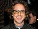"Robert Downey Jr describes Due Date director Todd Phillips as ""a genius""."