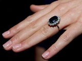 A close-up of Kate Middletons engagement ring as she poses with fianc Prince William in London, England