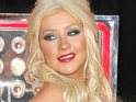 Christina Aguilera says that it's been difficult fr her to adjust to life as single, working mom.