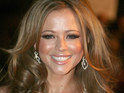 Kimberley Walsh criticizes Liz Hurley and Shane Warne for carrying out a flirtation over Twitter.
