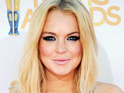An LA judge dismisses charges against a woman accused of breaking into Lindsay Lohan's home.