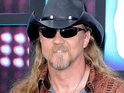 Country star Trace Adkins declares he's unhappy when his daughter listens to Justin Bieber's music.