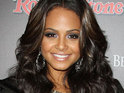 Christina Milian settles a lawsuit with an elderly neighbour attacked by her pet dog.