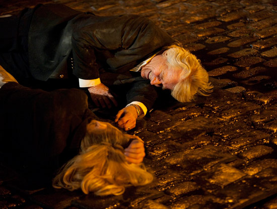 Ken Barlow (Bill Roache) and Leanne Battersby (Jane Danson) after being knocked down onto the cobbles by the explosion.